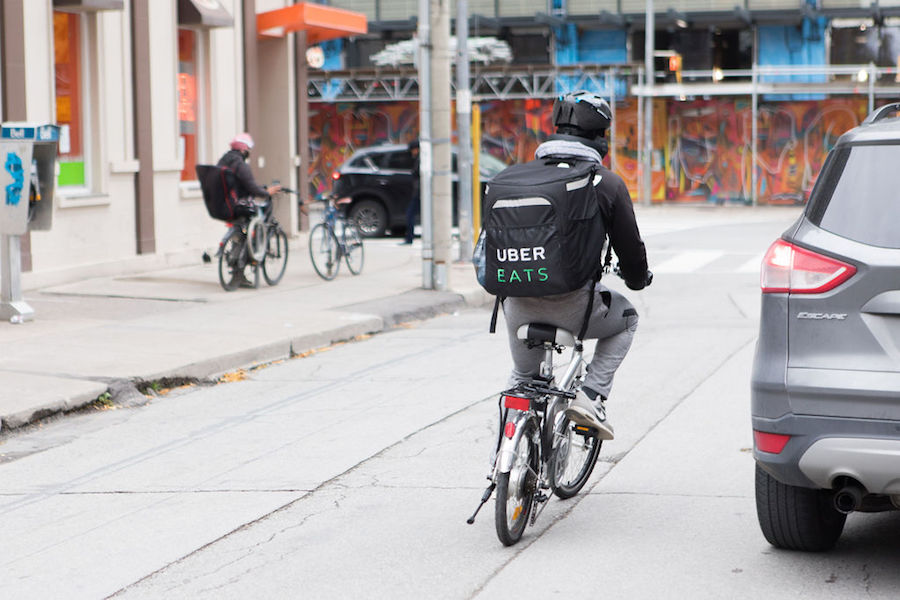 An Uber Eats bike delivery person