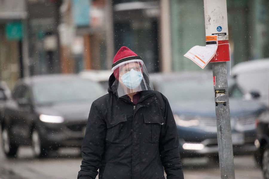 A photo of a person wearing a face shield in Toronto on February 19, 2021