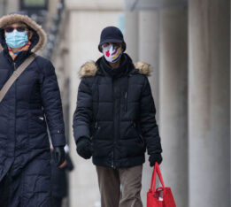 People wearing face masks in Toronto on February 22, 2021
