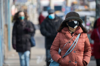 A photo of a person wearing a mask in Toronto during the COVID-19 pandemic