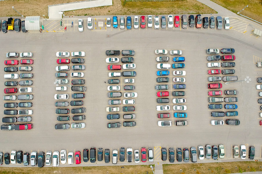 A photo of a parking lot full of cars