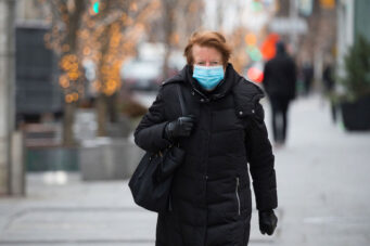 A person wearing a face mask in Toronto