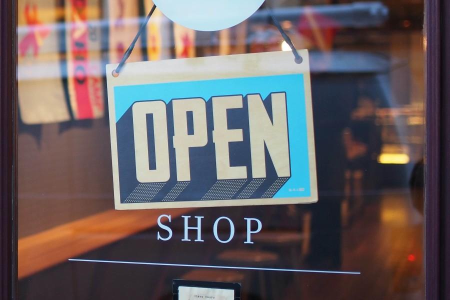 A photo of an open sign in a store window