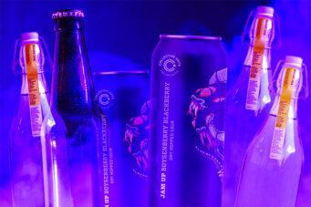A photo of three purple drinks