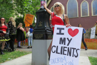 A photo of a sex worker protesting sex work law in Canada