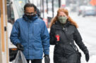 People wearing face masks during the COVID-19 pandemic in Toronto on February 22, 2021