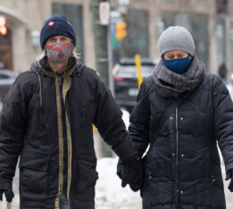 A photo of people wearing face masks in Toronto during the COVID-19 pandemic on February 22, 2021