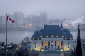 A photo of the Supreme Court of Canada building shrouded in fog