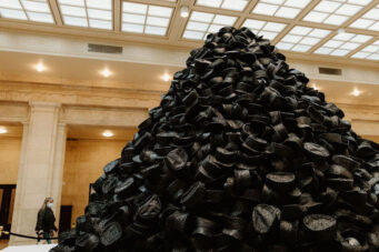 A photo of Jordan Sook's 15 ft sculpture comprises handcrafted hats at Union Station
