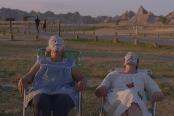 A photo of Linda May and Frances McDormand in the film NOMADLAND.