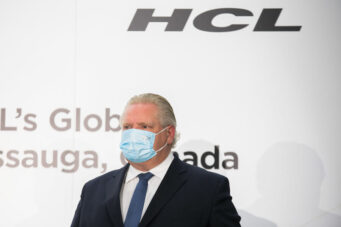 A photo of Doug Ford in a face mask