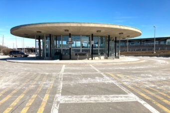 A photo of Wilson Subway Station surrounded by an empty parking lot
