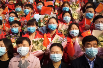A group of Chinese health-care workers attend a ceremony in their honour in Wuhan