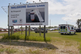 A billboard advertises nalaxone in The Kainai Nation in Alberta