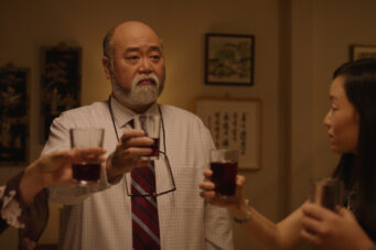 Paul Sun-Hyung Lee gives a toast in the finale episode of Kim's Convenience.