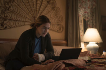 A photo of Kate Winslet looking at a laptop in Mare Of Easttown