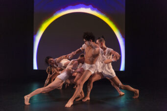 A photo of Red Sky Performance dancers under LED lights