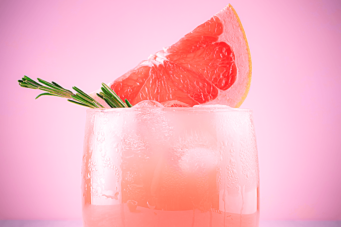 A photo of a Paloma cocktail with a grapefruit garnish