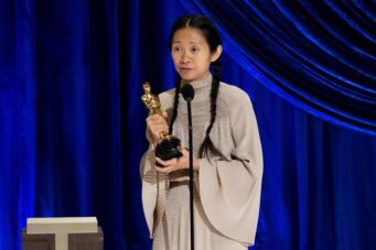 An image of Chloe Zhao accepting an Academy Award