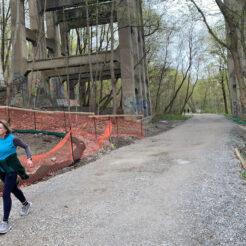 A woman walks along the Rosedale Ravine Trail