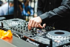 A photo of a person working as a DJ