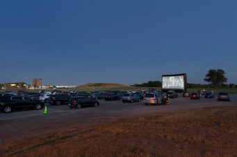 A photo of cars parkedat a drive-in cinema at Downsview Park in Toronto