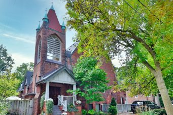 A church condo unit with a giant spire is listed on the Toronto real estate market